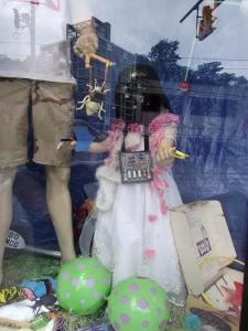 Girly doll in Darth Vader mask in Big Fun window